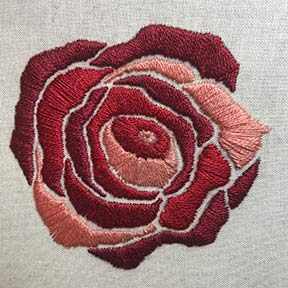 Red rose satin stitched embroidery.