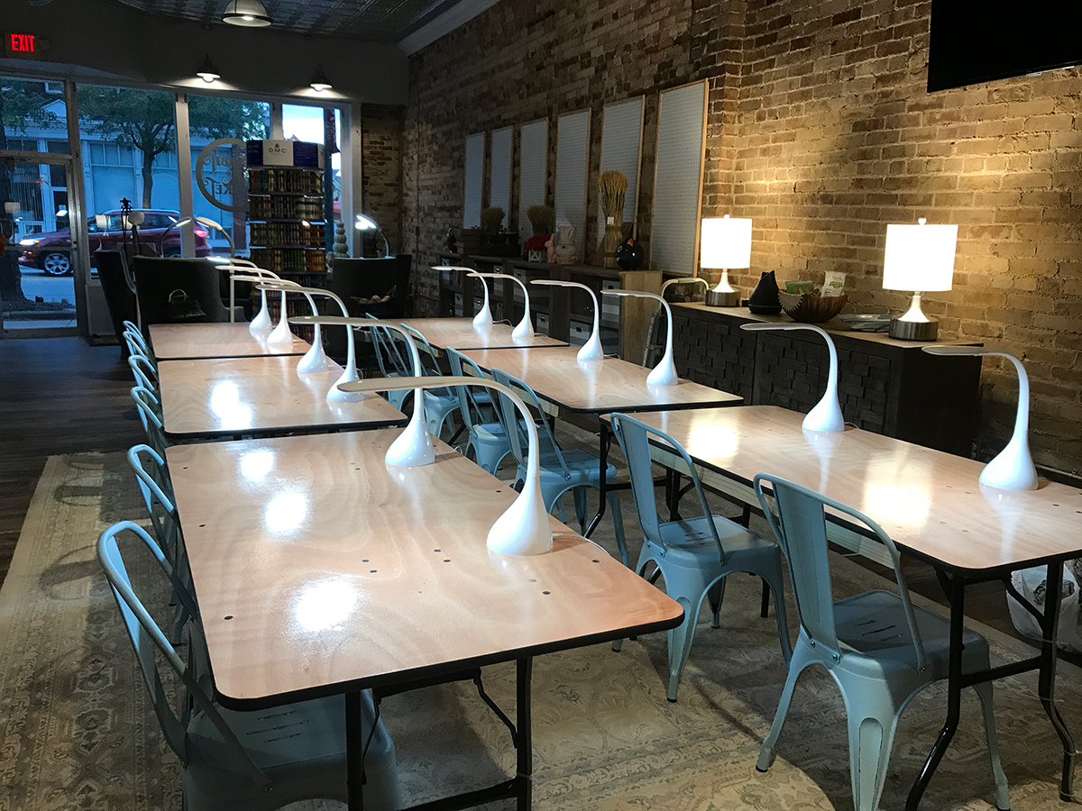 Workshop area featuring six tables with individual seating and lighting for 12 students at Rabbit & Rocket in Lancaster, Ohio.