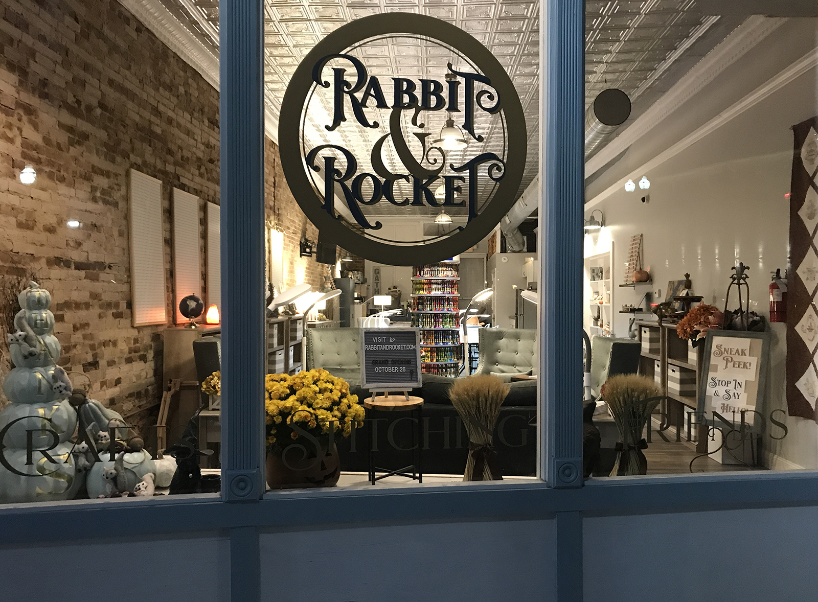 Storefront view of Rabbit & Rocket showing soft seating area and window signage.