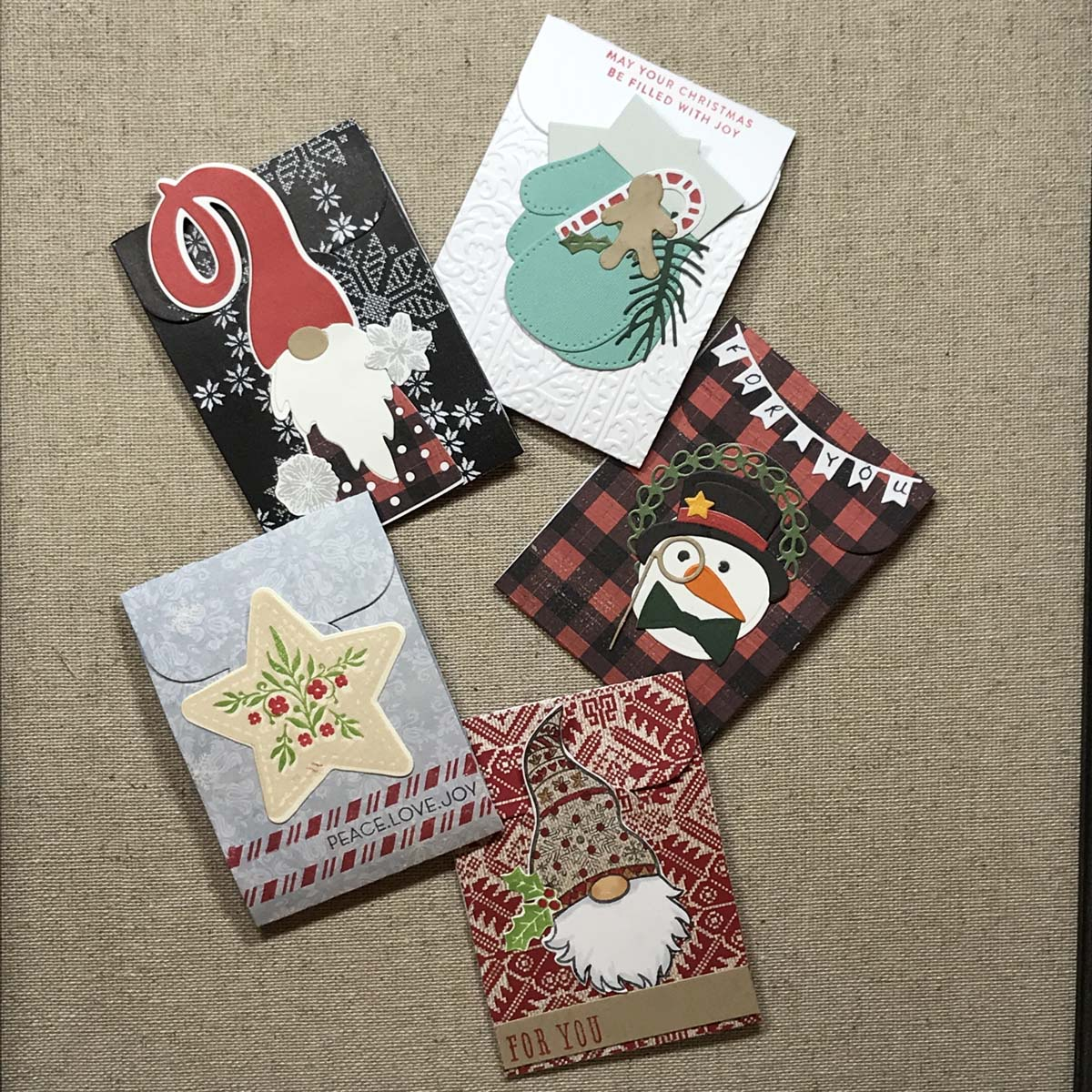 Five custom gift card holders featuring holiday themed decorations