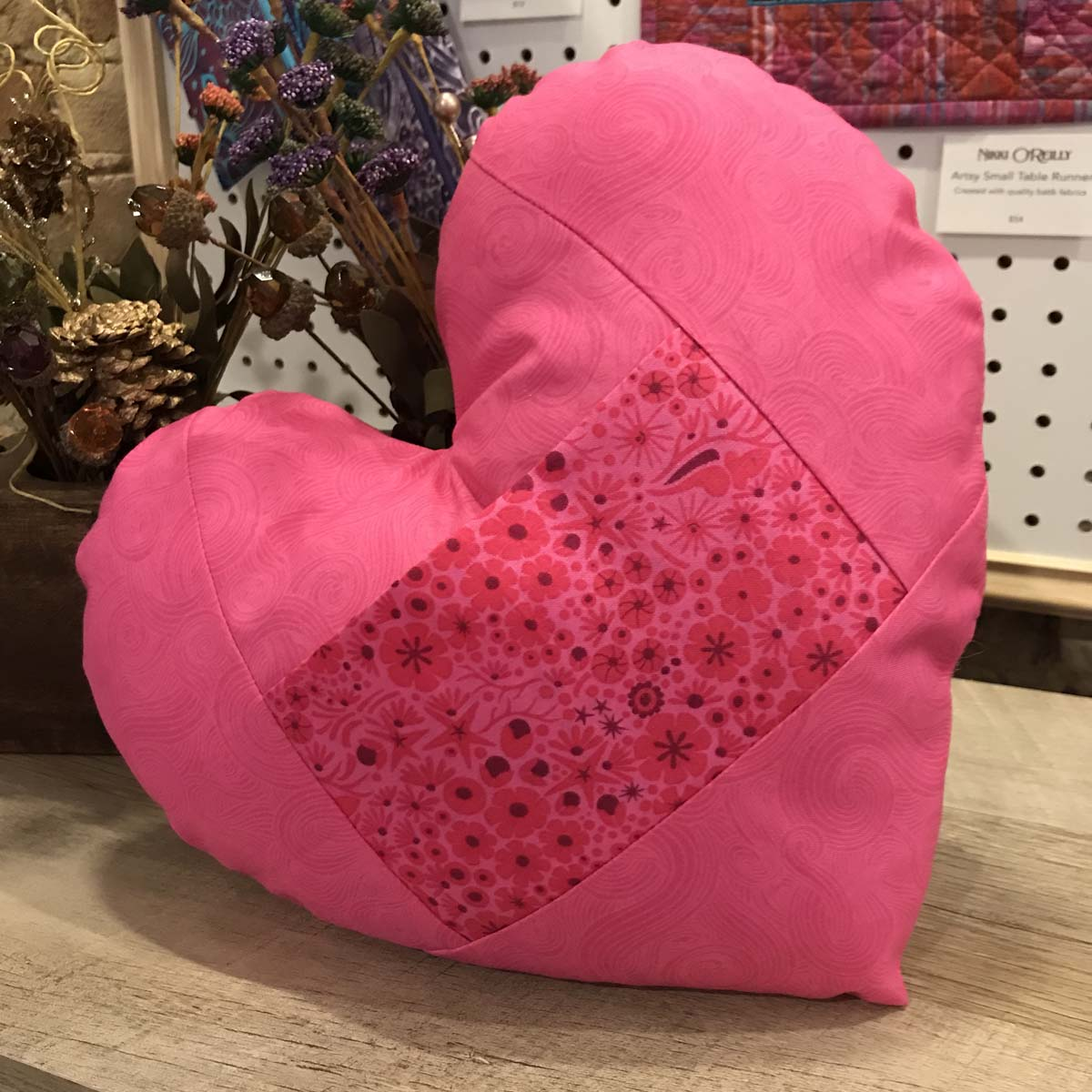 Heart-shaped pink pillow with love note pocket.