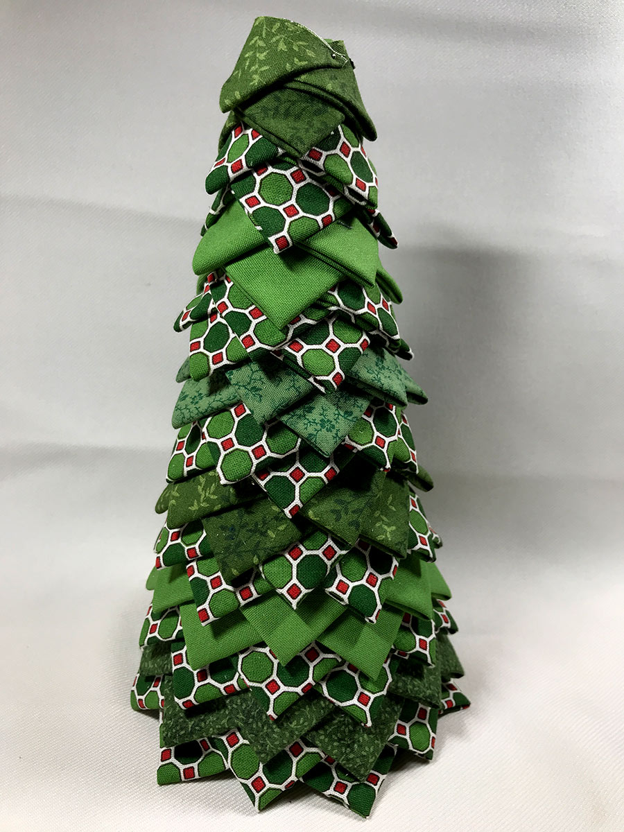 Christmas Tree decoration made of folded triangles of fabric on a cone form.
