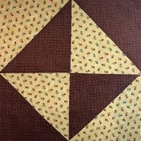 Quilt block featuring Civil War colorway and fabric in envelope style pattern.