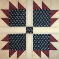 Quilt block in red, white and blue Civil War colorway.