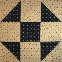 Quilt block pattern featuring navy and cream Civil War era colorway and fabric.