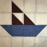 Quilt block featuring boat pattern in Civil War era color way.