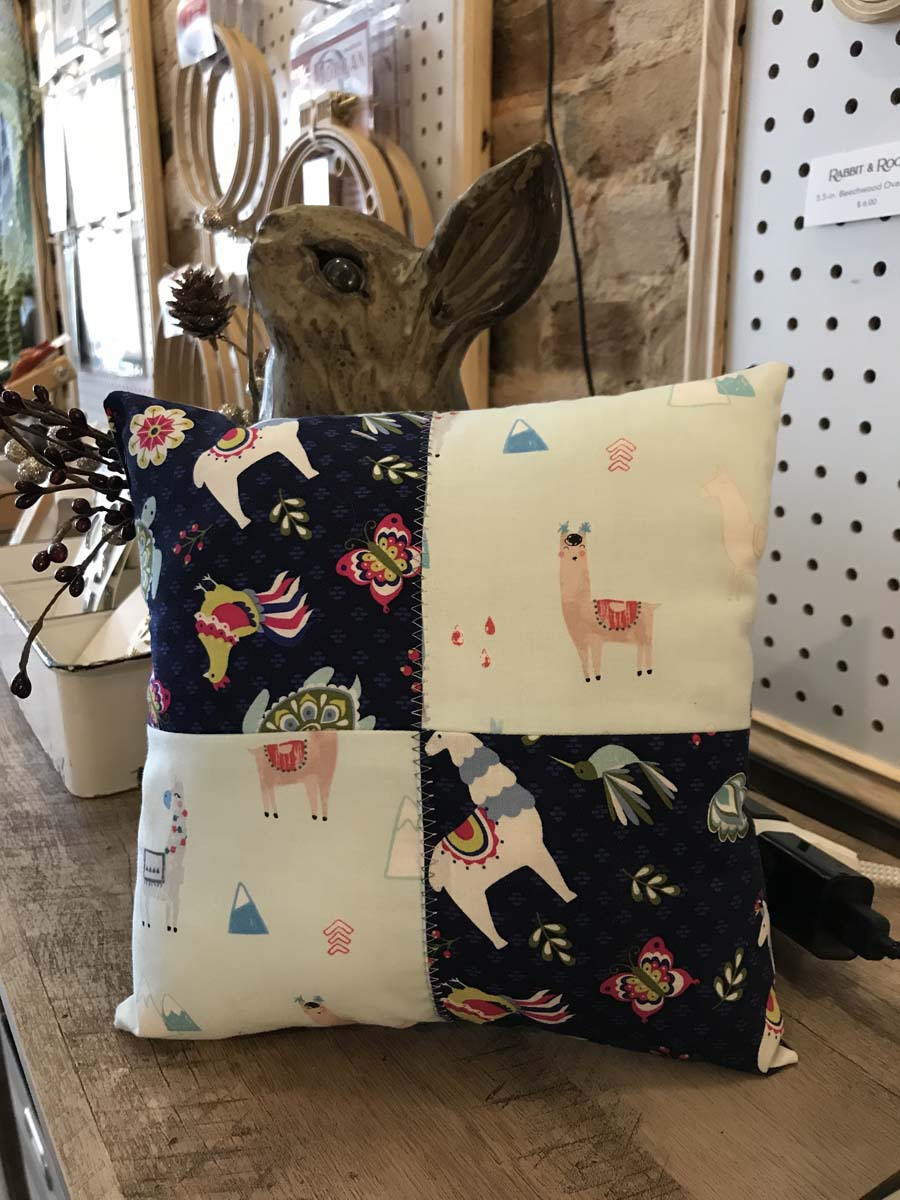 Pillow with four square motif using llama character fabrics.
