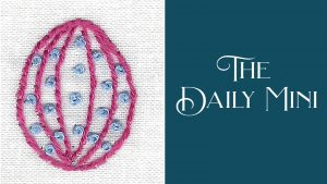 Daily Mini announcement with embroidered Easter egg with pink stripes and blue dots.