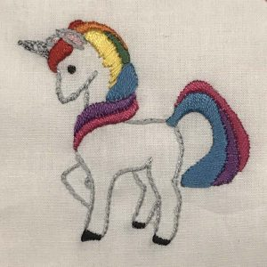 Hand-embroidered unicorn with rainbow mane and tail.