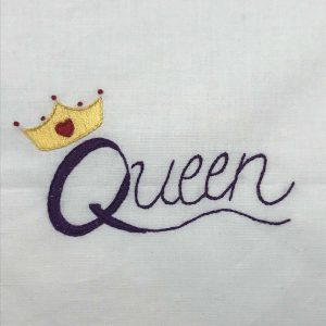 Hand-embroidered word Queen in purple with gold crown.