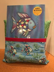 Memory Keeper Pocket Pillow with children's book in the pocket.