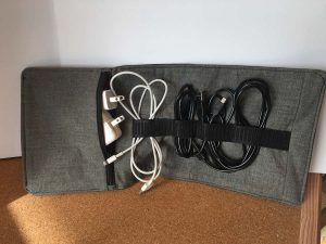 Zippered Cord Keeper with cords and chargers stored.