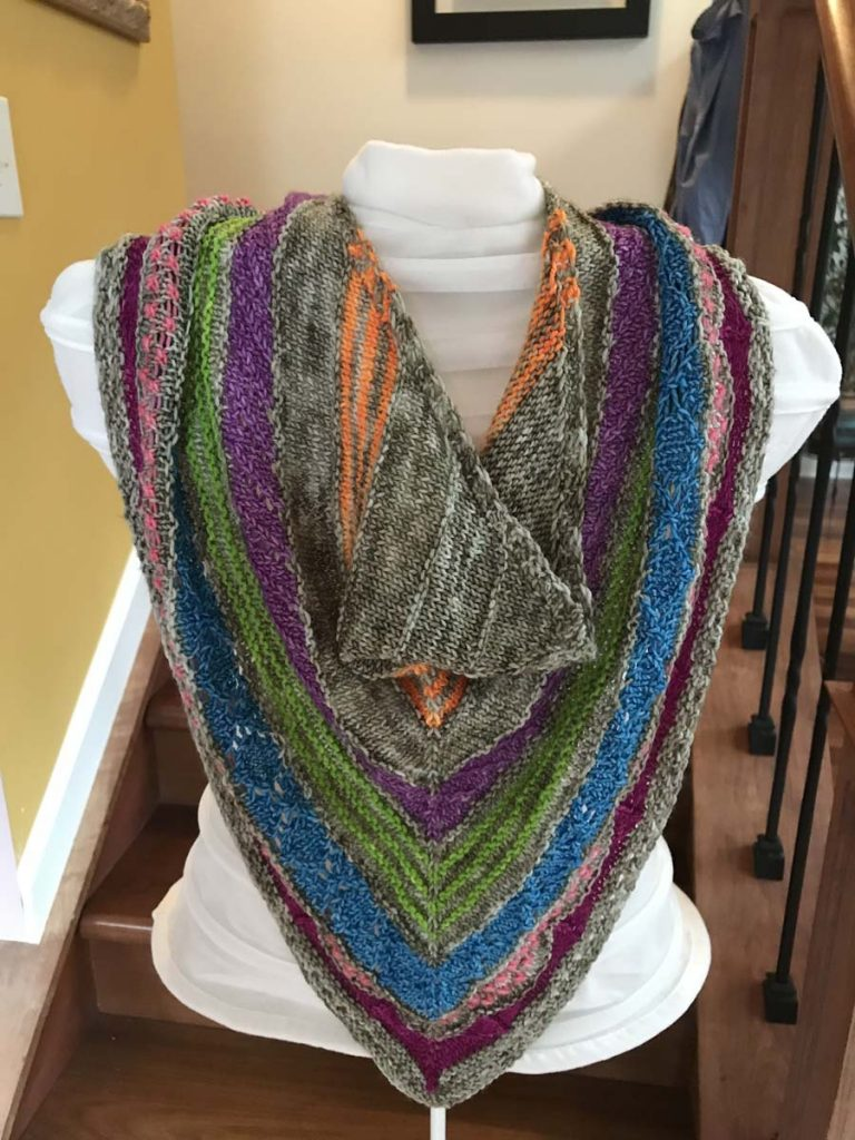 The Shortcut Cowl as knitted by Laura Regan, draped on white torso mannequin.