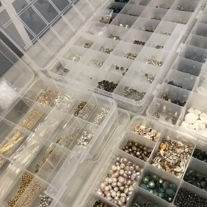Tray of jewelry making beads and stones.