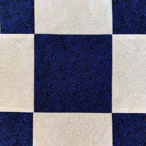 Blue and white square pattern quilt block.