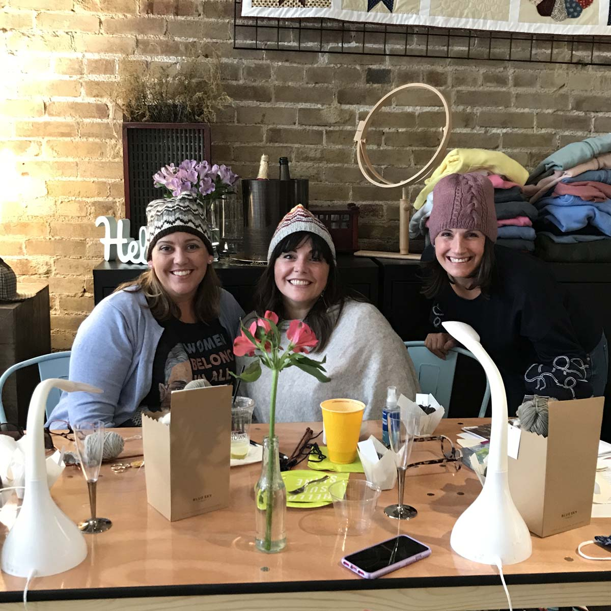 Three friends in knitted hats.
